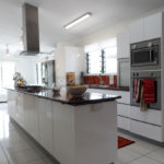 Kitchen timber bench red splashback